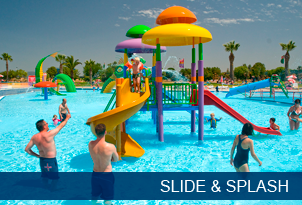 Families playing on water slides at Slide and Splash Algarve water park