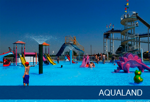 Kid by water slides at Aqualand Algarve water park